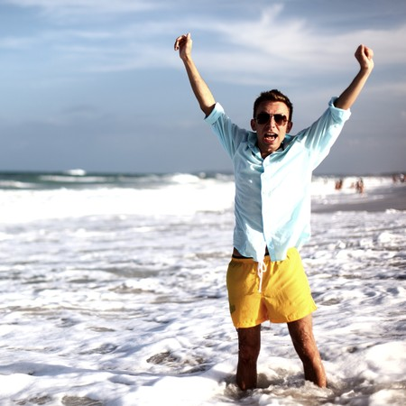 young man on vacation happiness in water photo
