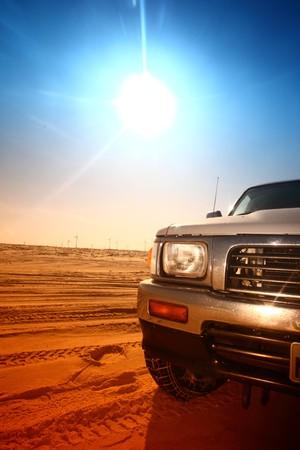 truck in desert sand and blue sky photo