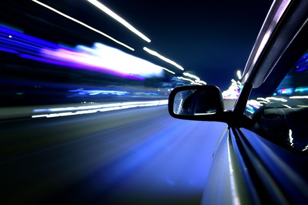 car fast drive on highway in night Stock Photo - 4279242