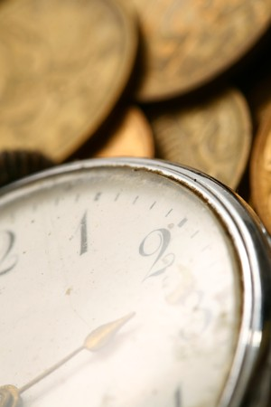 time is money coins and clock macro concet Stock Photo - 4279249
