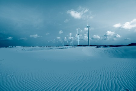 desert windmills in dunes energy photo