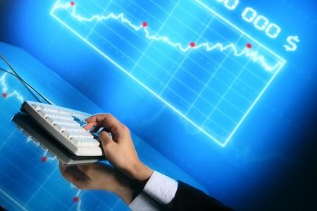 input: businessman input finance data information on keyboard