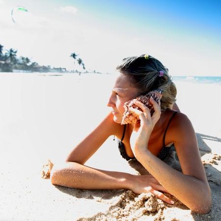 pretty girl call by shell phone photo