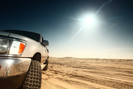 customized: truck in desert sand and blue sky