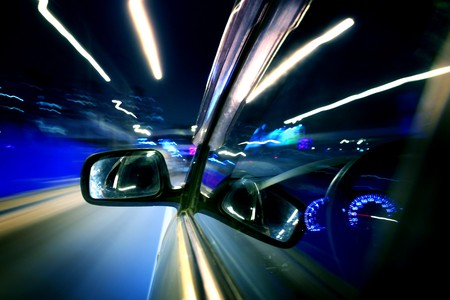 car fast drive on highway in night Stock Photo - 4324456