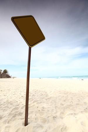 desert sign in sand under palm Stock Photo - 4324834