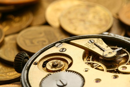 time is money coins and clock macro concet Stock Photo - 4342779