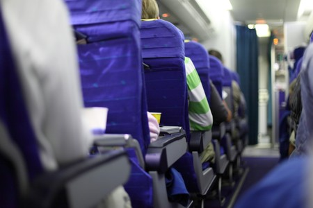 airplane seats in row on board Stock Photo