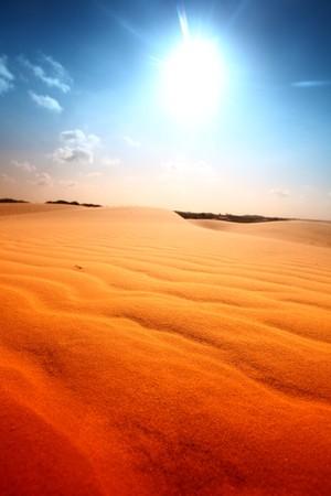 desert sand under blue sunny sky Stock Photo