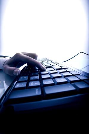 hand press a key on keyboard Stock Photo - 4363306