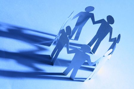 paper team linked together partnership concept Stock Photo - 4615982