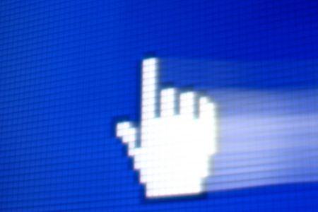 finger corsor on blue pixel screen photo