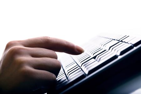 hand press a key on keyboard Stock Photo - 4616009