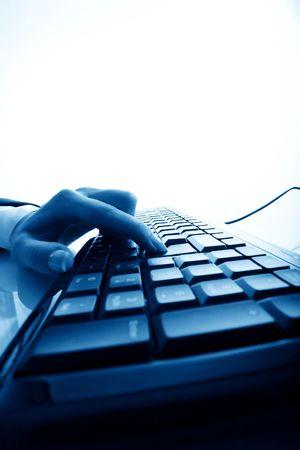hand press a key on keyboard Stock Photo - 4616116