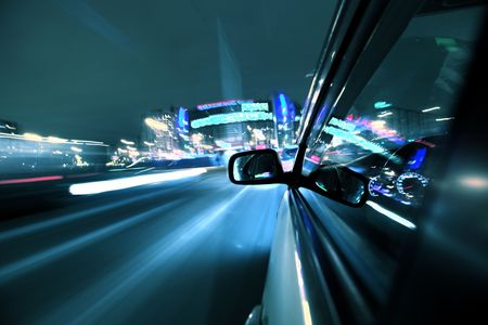 car fast drive on highway in night Stock Photo - 4644369