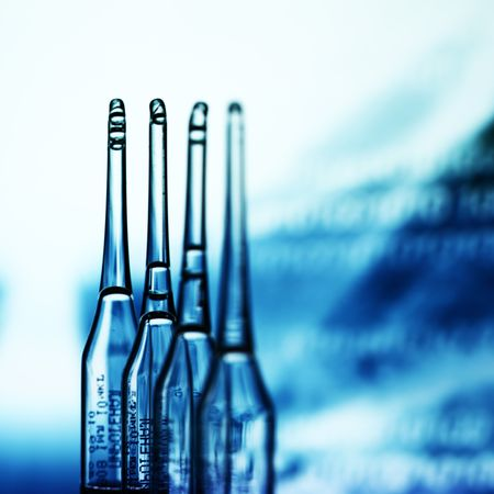 ampoule on abstract bokeh background Stock Photo - 4976875