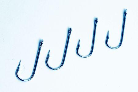 fishing hooks macro close up on white Stock Photo - 4977781