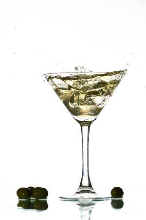 spilling: martini splash on white bar background