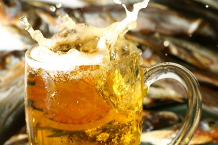 golden beer splash in glass Stock Photo - 4995616