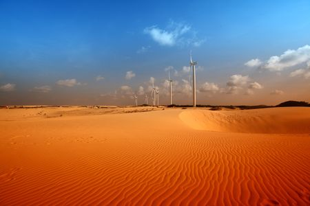 desert windmills in dunes energy photo