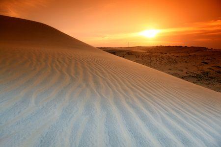erg: desert sand under blue sunny sky Stock Photo