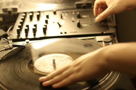 disc jockey: scratch battle of dj playing on his vinyls hand on