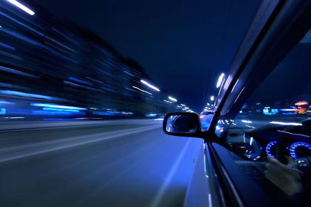 car fast drive on highway in night Stock Photo - 4996235