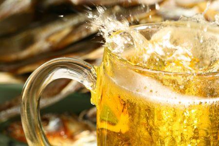 single beer: golden beer splash in glass