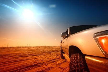 suv: truck in desert sand and blue sky