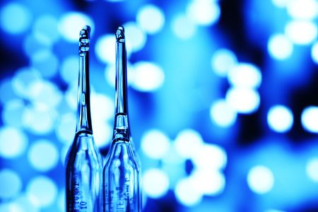 ampoule on abstract bokeh background Stock Photo - 5019381