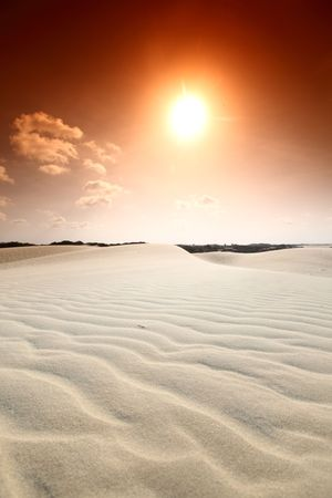 arid: desert sand under blue sunny sky Stock Photo
