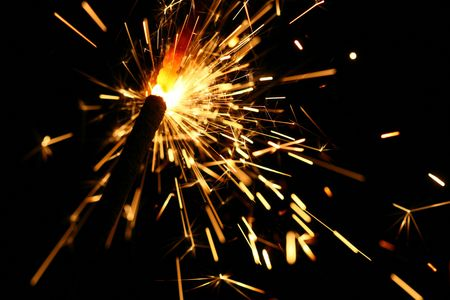 yellow sparkler holiday background on black Stock Photo - 5019563