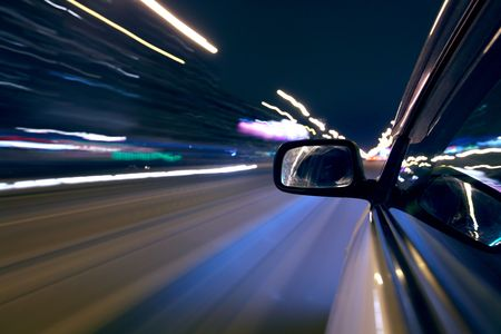car fast drive on highway in night Stock Photo