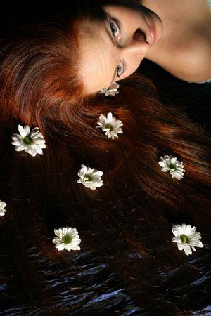 beautiful white flowers in girl hair photo