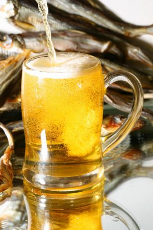 golden beer splash in glass photo