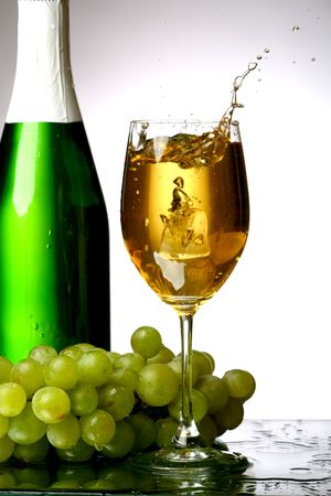 champagne splash grape and green bottle Stock Photo - 5956275