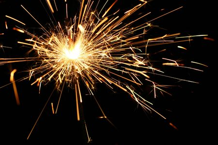 yellow sparkler holiday background on black photo