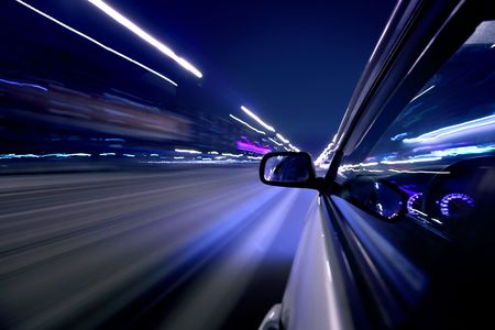 car fast drive on highway in night Stock Photo - 5956771