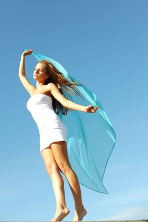 woman fly in the blue sky by fabric Stock Photo - 6315711