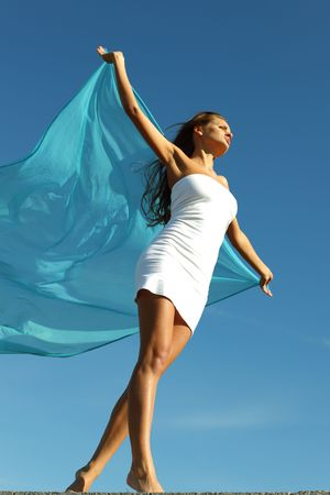 woman fly in the blue sky by fabric Stock Photo - 6315505