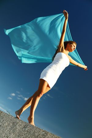 woman fly in the blue sky by fabric Stock Photo - 6315514