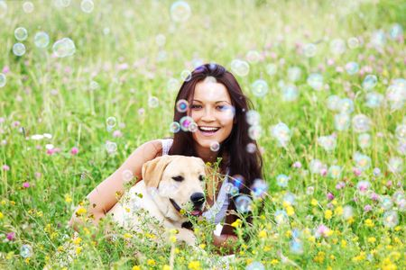 woman and she lablador dog in green grass Stock Photo