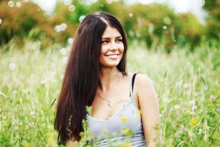 happy woman smile in green grass soap bubbles around Stock Photo - 6316815