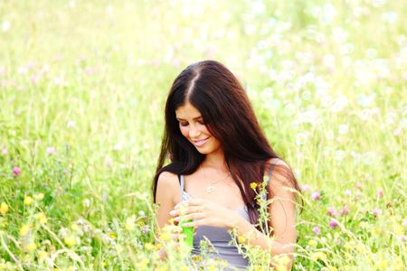 happy woman smile in green grass soap bubbles around Stock Photo - 6313877