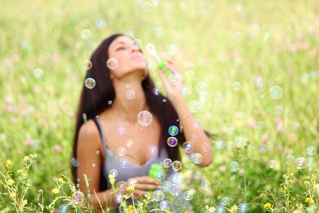 happy woman smile in green grass soap bubbles around Stock Photo - 6317158