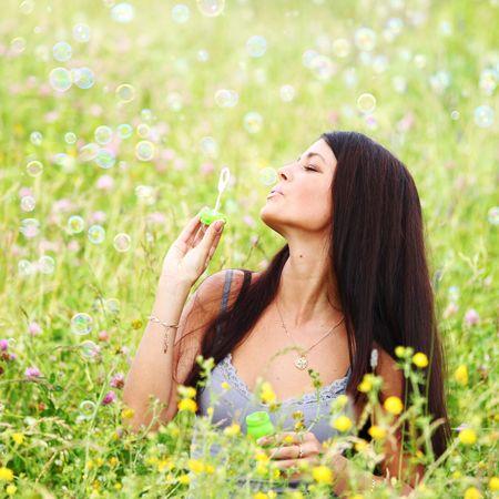 happy woman smile in green grass soap bubbles around Stock Photo - 6316379
