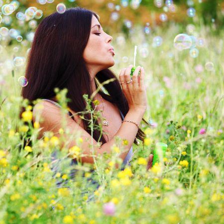 happy woman smile in green grass soap bubbles around Stock Photo - 6316656