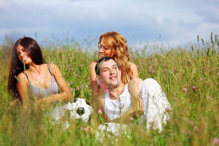 friends and dog in green grass field Stock Photo - 6318204