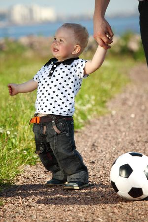 little boy play soccer outdoor photo