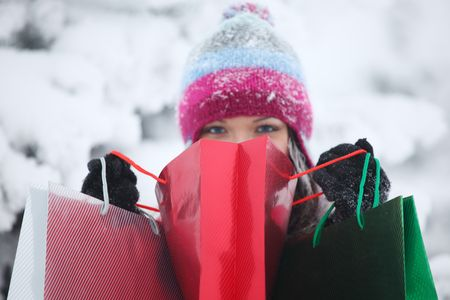 winter girl with gift bags on snow background Stock Photo - 6315709